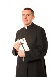 This priest is a member of the clergy. A clergyman or clergyperson.