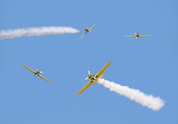 Four airplanes performing aerobatics.