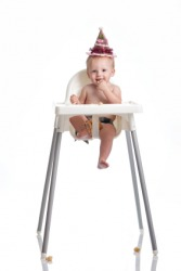A baby sitting in a highchair.