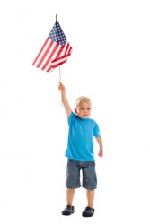 A child raises a flag.